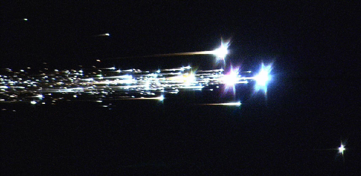 Image of the Hayabusa Reentry into Earth's Atmosphere. The main spacecraft broke-up and burned in the upper atmosphere, generating a multitude of bright streaks in the sky.