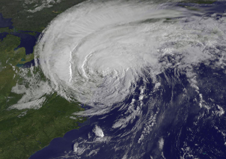 Image of a Hurricane from Space. This photograph shows a huge, inverted-comma shaped storm covering much of the north-east coast of the United States.