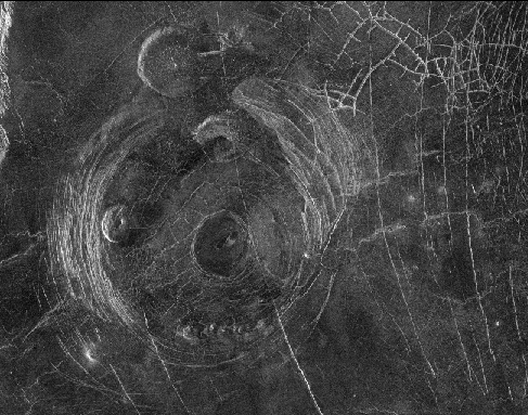 The Fotla Corona. This circular volcanic feature, when seen from above, has the appearance of the beloved Muppets character. Three pancake volcanoes lie within the corona, one below center for the snout, one above and one to the left for the eyes. A single pancake volcano above and outside the corona forms one of the ears.