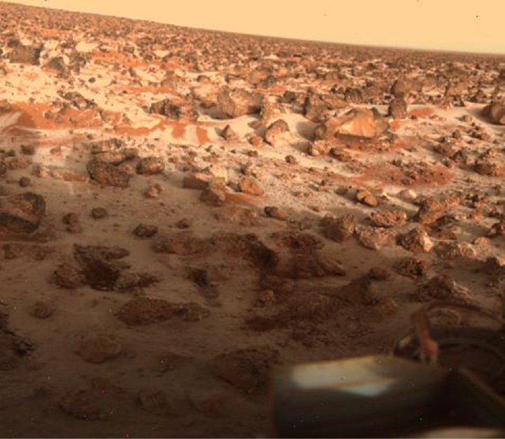 Winter on Mars. A thin layer of white frost covers the soil and parts of some of the rocks and boulders in this Viking 2 image.