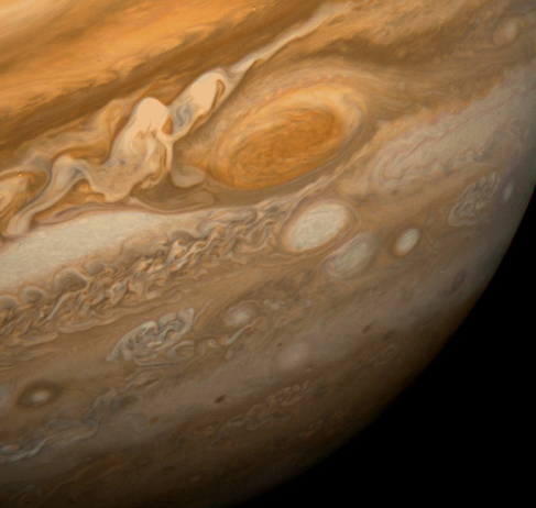 Jupiter's Dynamic Clouds. The oranges, reddish browns, taupes and beiges of Jupiter's dynamic atmosphere are seen swirling around the Great Red Spot in this close-up image of Jupiter.