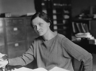 An image of Cecilia Payne-Gaposchkin seated at a desk.