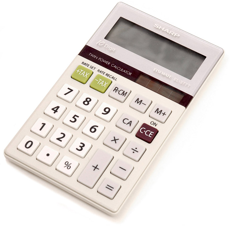 Photograph of a small calculator having a strip of solar cells just above the keys.