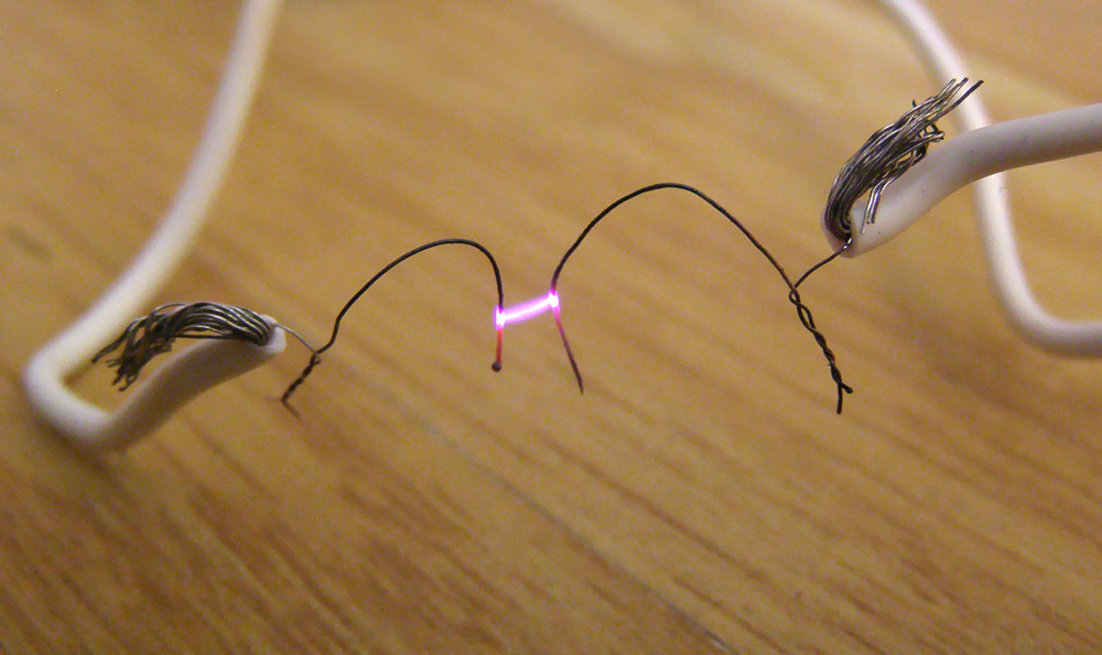 Photograph of an electric arc produced between two multi stranded wires close to each other but not in contact.