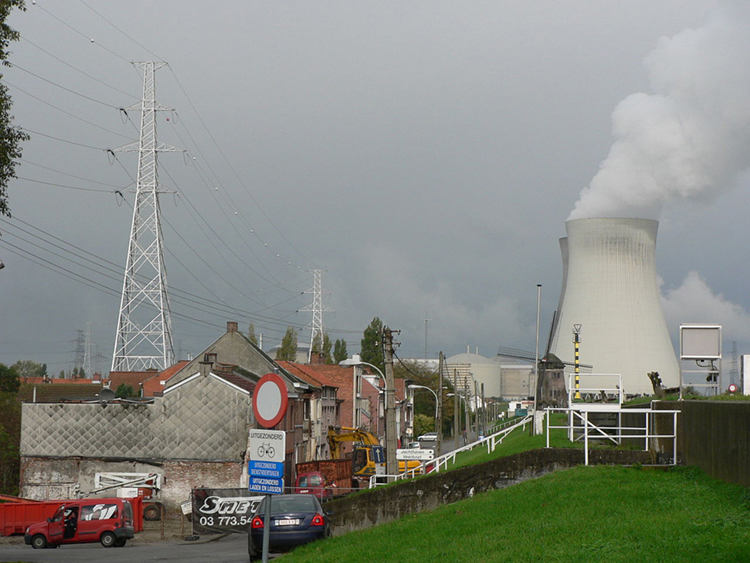 The image shows people living in their homes located near a nuclear power plant.