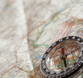Photo showing compass and map
