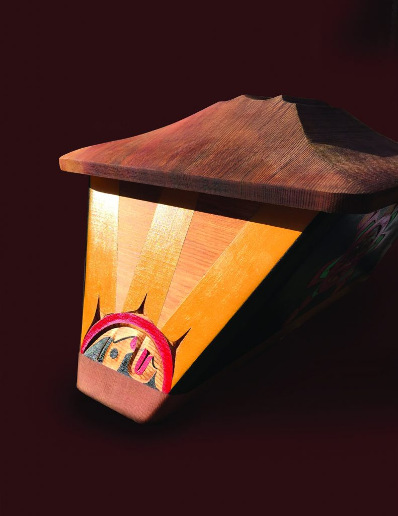 Bentwood box depicting sun taking over the world by 'N<u>a</u>m<u>g</u>is master artist Bruce Alfred