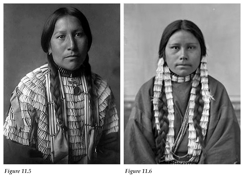 Oglala Sioux woman wearing a dress adorned with dentalium shells and woman with braided hair adorned with dentalium shells