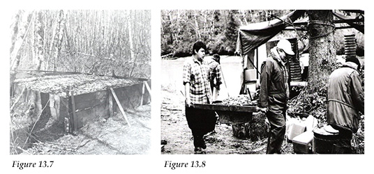 Oolichan pit; Arthur Dick Sr. and Jr. carrying a tub of dzaxwan