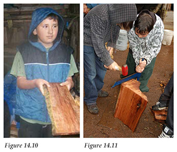 Student displays a cedar plank; students practice making cedar planks