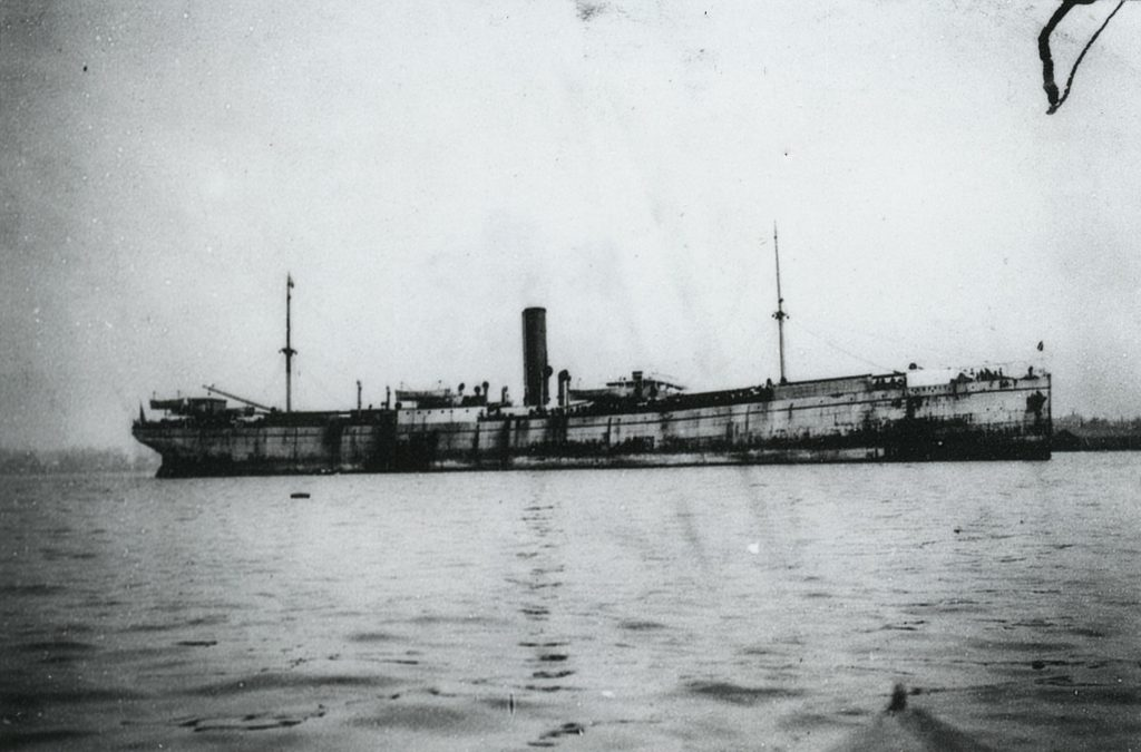A photo of the passenger ship S.S. Kumeric floating in harbor.