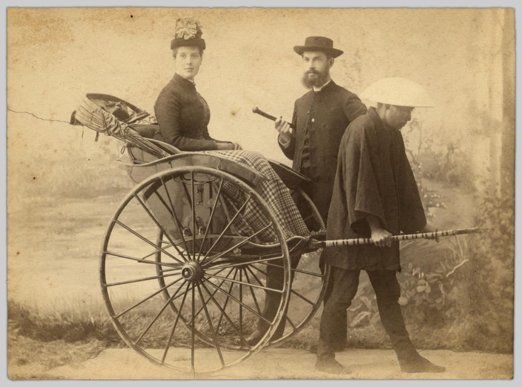 A portrait of John and Bessie Robinson (1888) by Tanaka Miyoji. Bessie is sitting in a rickshaw pulled by an unknown Japanese man.