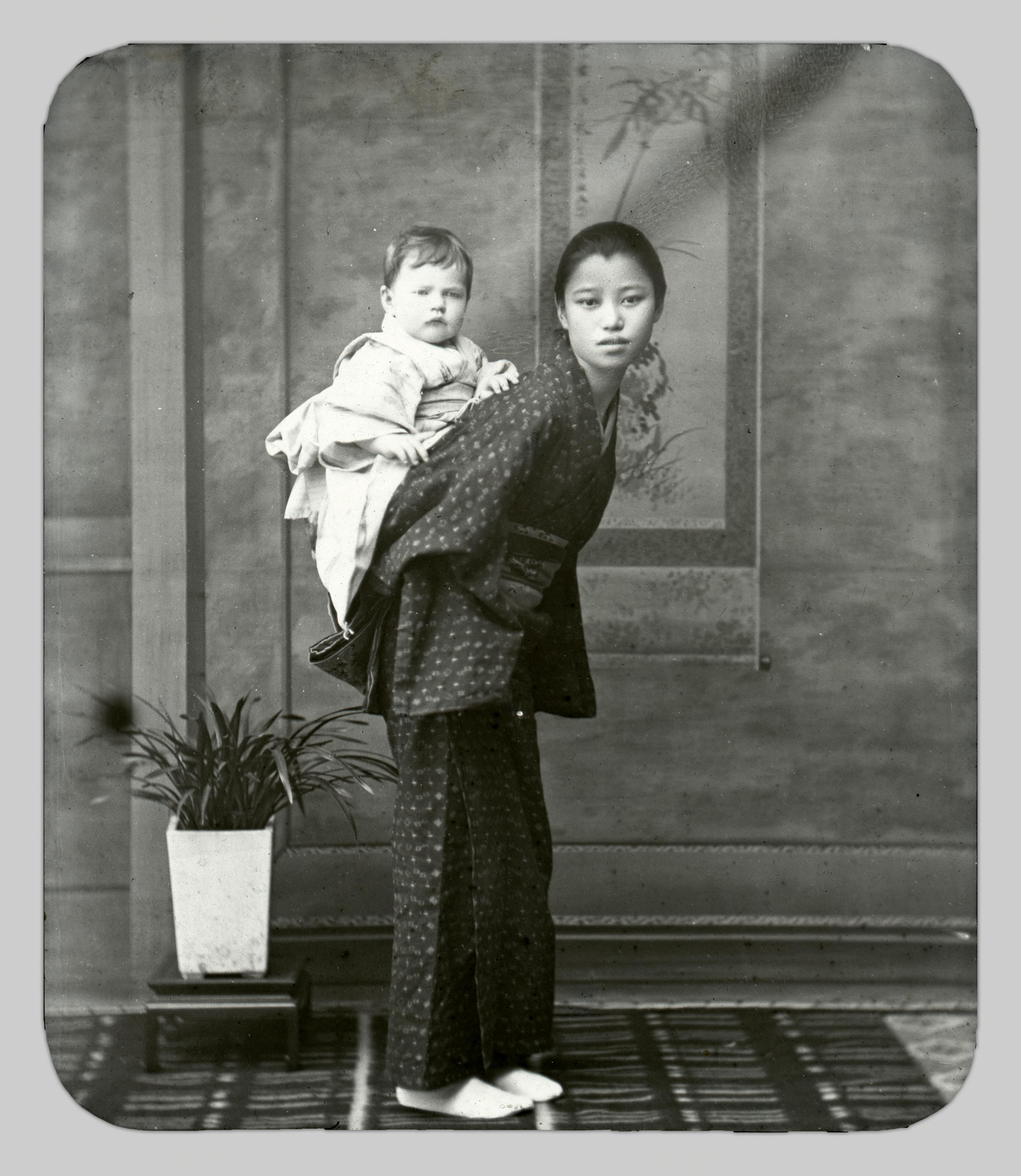 A photograph by Miyashita Kin depicting a studio model holding John Cooper Robinson's infant daughter, Hilde, on the model's back.