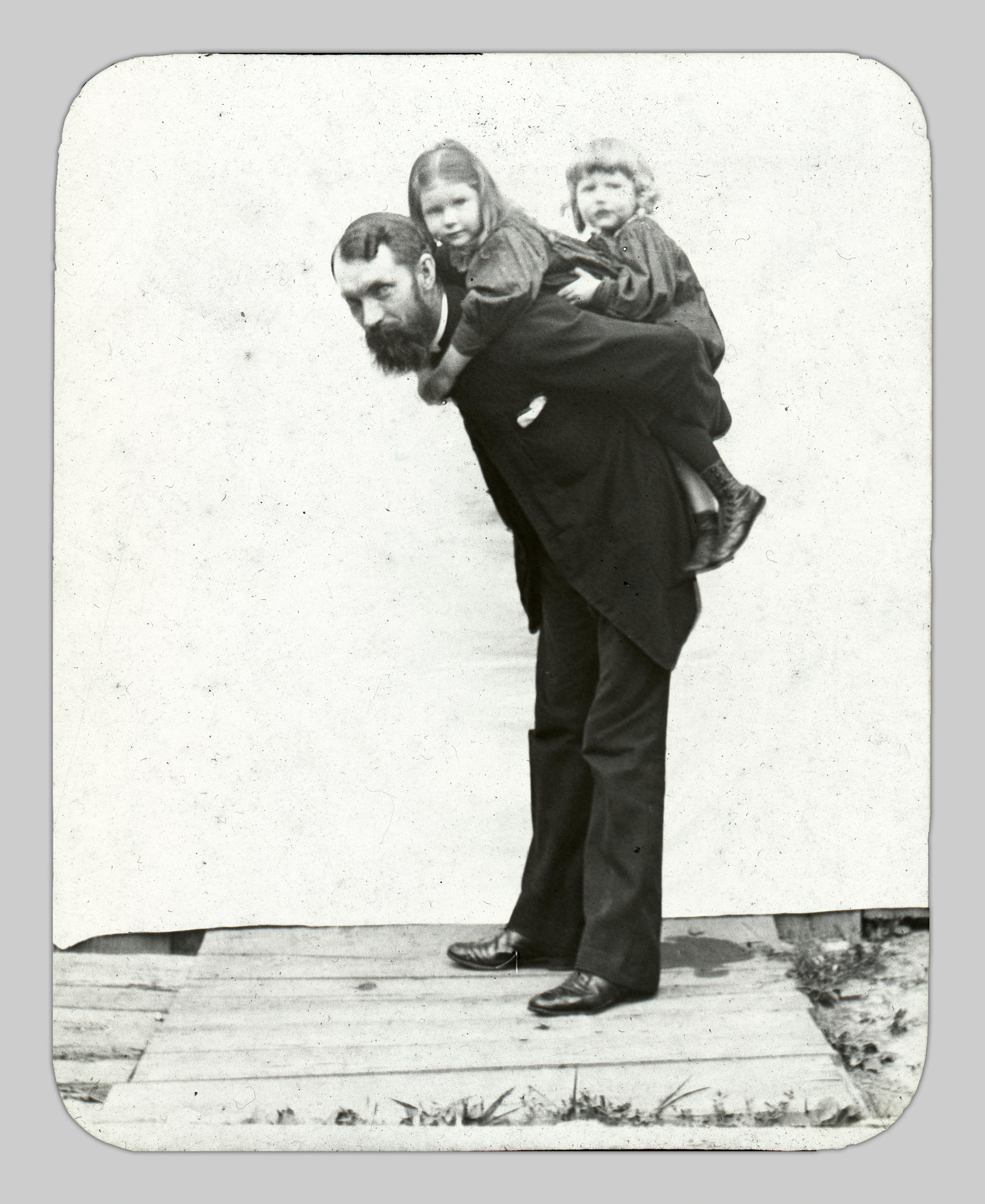"""A portrait of John Cooper Robinson holding his young daughters, Lucy and Hilde, in a similar manner to the """"Nurse and Child"""" photos and the studio photo in Figure 18."""