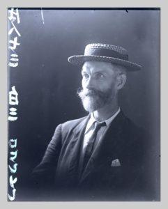 A portrait of John Cooper Robinson with studio inscription along the side.