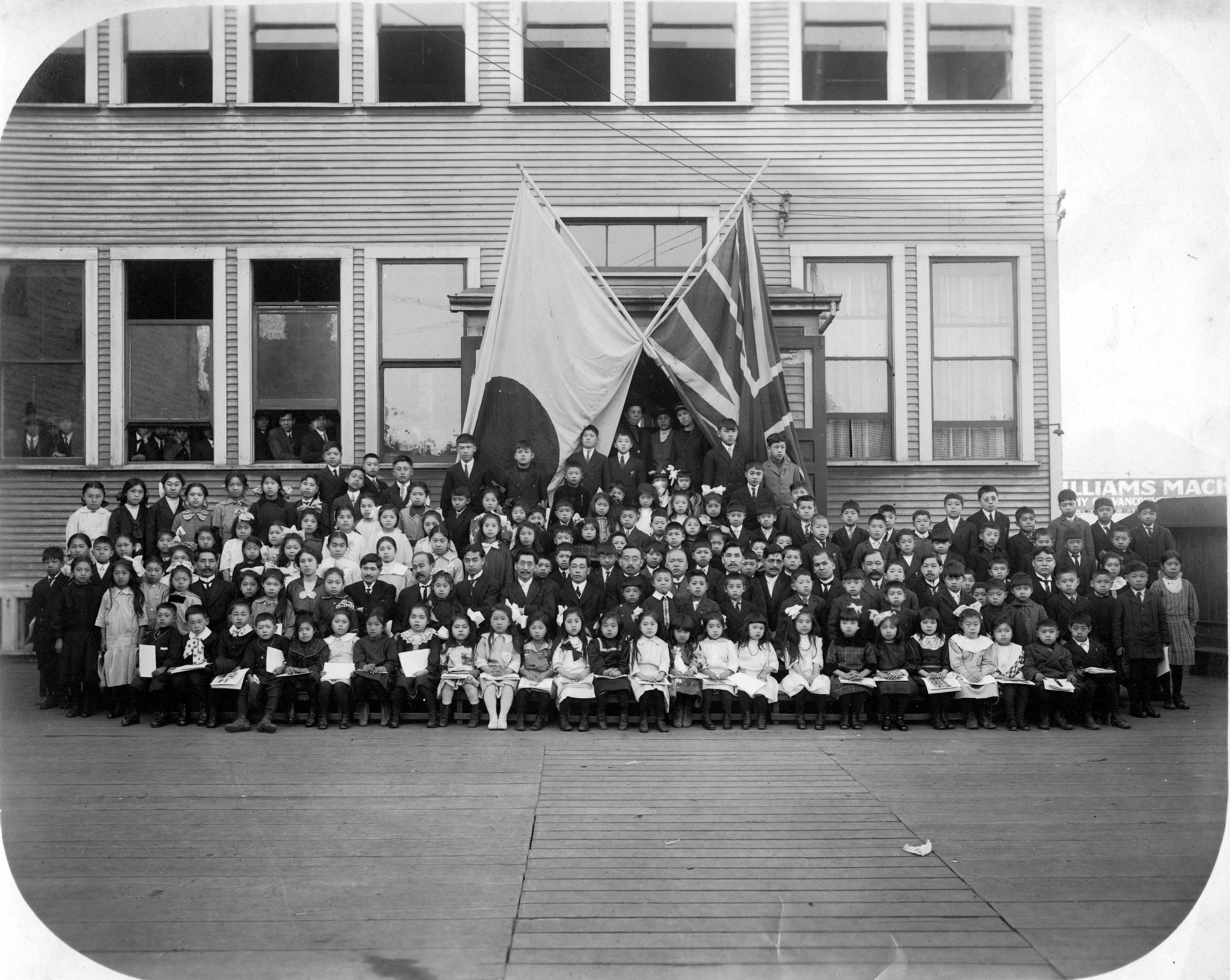 Another photo of a graduate class in front of the school.
