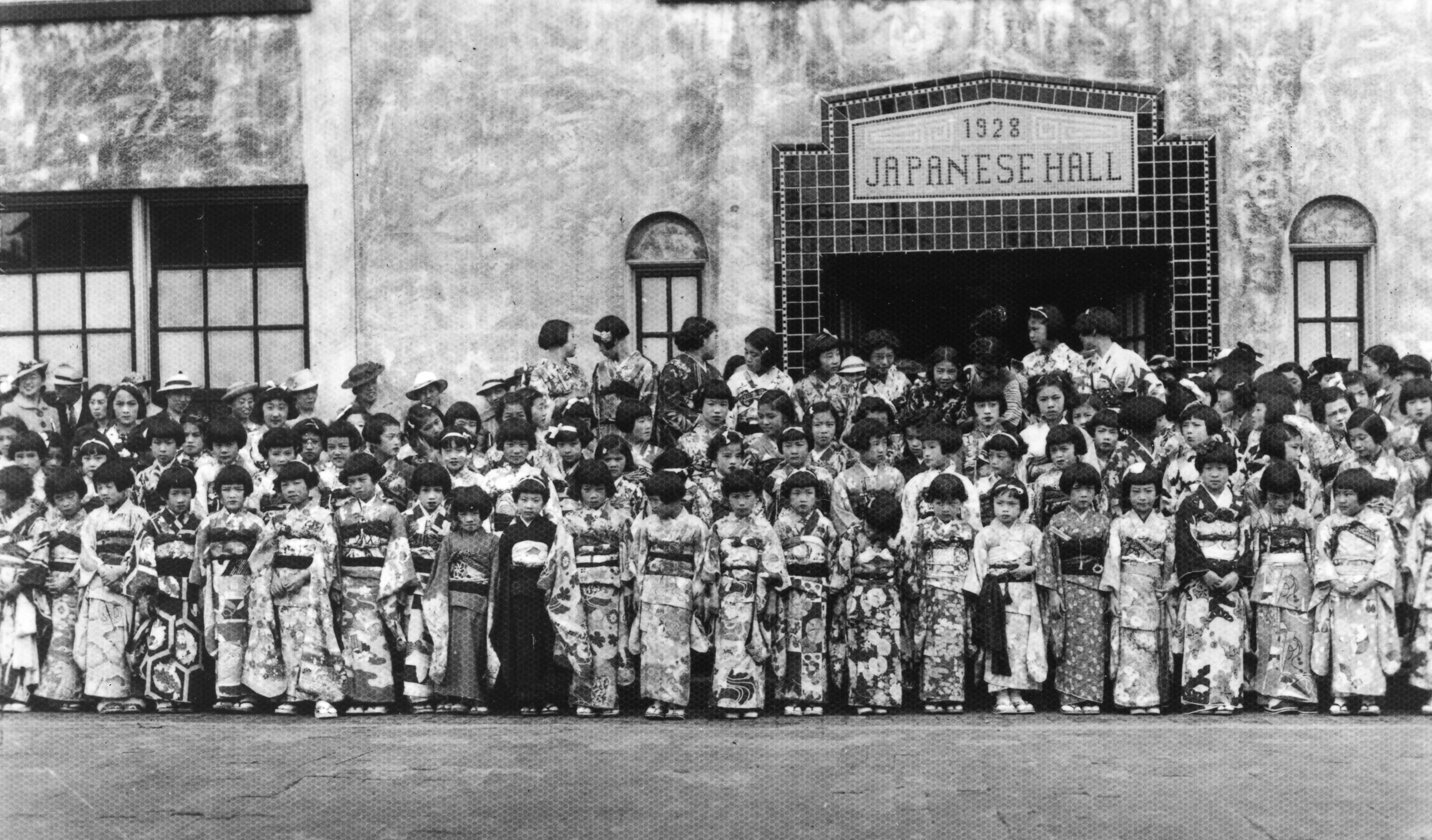 In this photo, a large group of girls wait for the King and Queen outside the Language School.