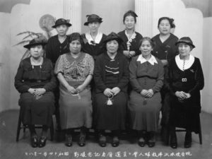 Here, seven women pose for a photo at a kanreki celebration, or sixtieth birthday of members of the Buddhist Women's Association, in Vancouver in 1939.