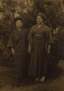 A grown Hilda Robinson, in Japanese dress, poses for a photo with a Japanese colleague of the Robinson family.