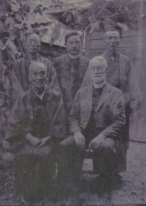 In this photo, John Cooper Robinson poses with four men who were likely Japanese Christians.