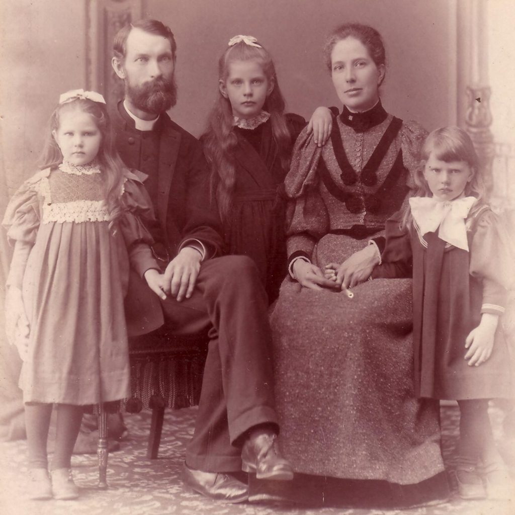 This is a portrait dating to the late 1890s, of John Cooper Robinson, his wife Bessie, and his daughters. Robinson and Bessie are seated, while the three daughters stand next to them.