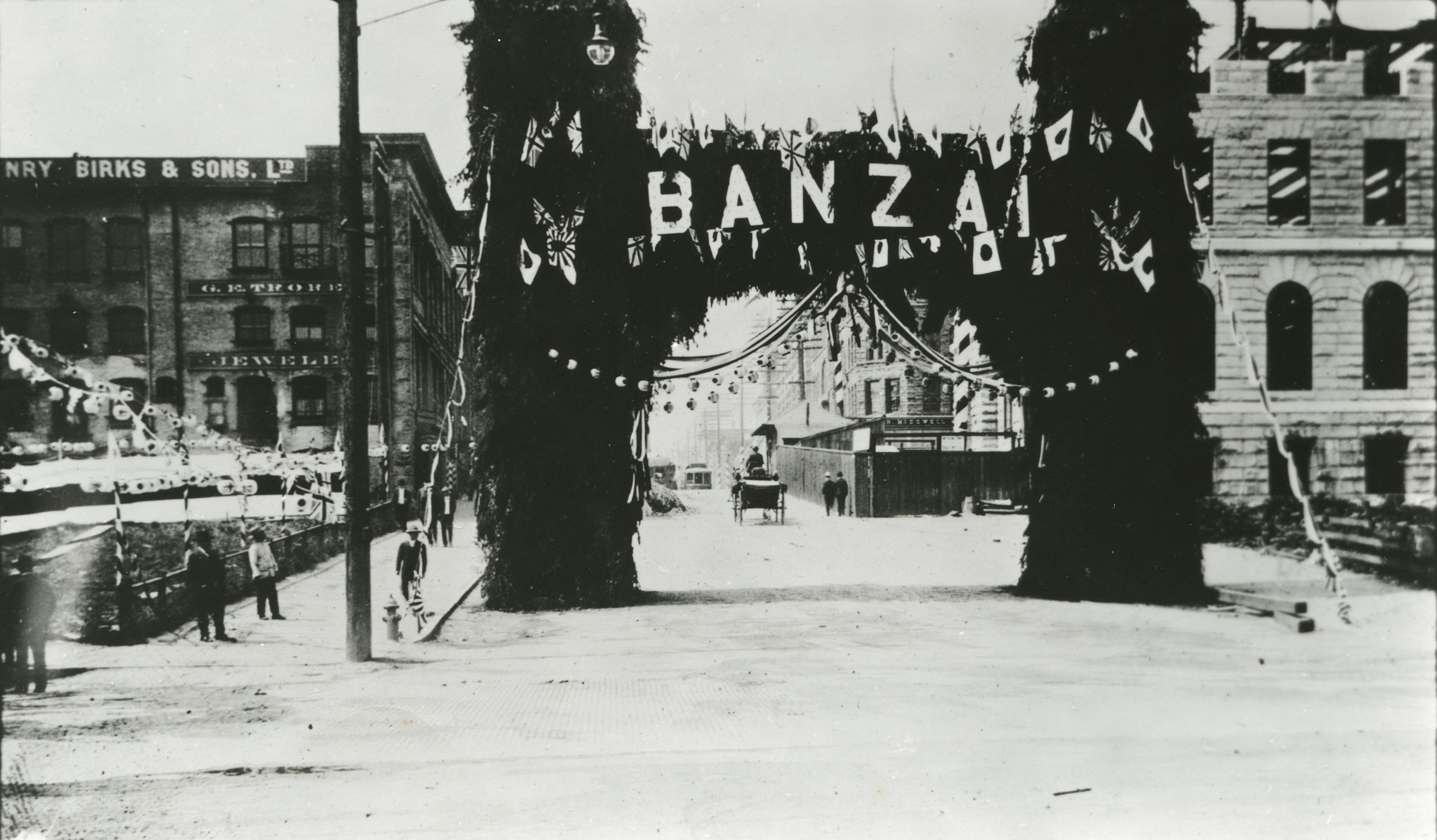"A view of a gate, decorated with Japanese flags and the word ""Banzai"" in large lettering, at the foot of Granville Street in honor of Prince Fushimi's visit to Vancouver in 1907."