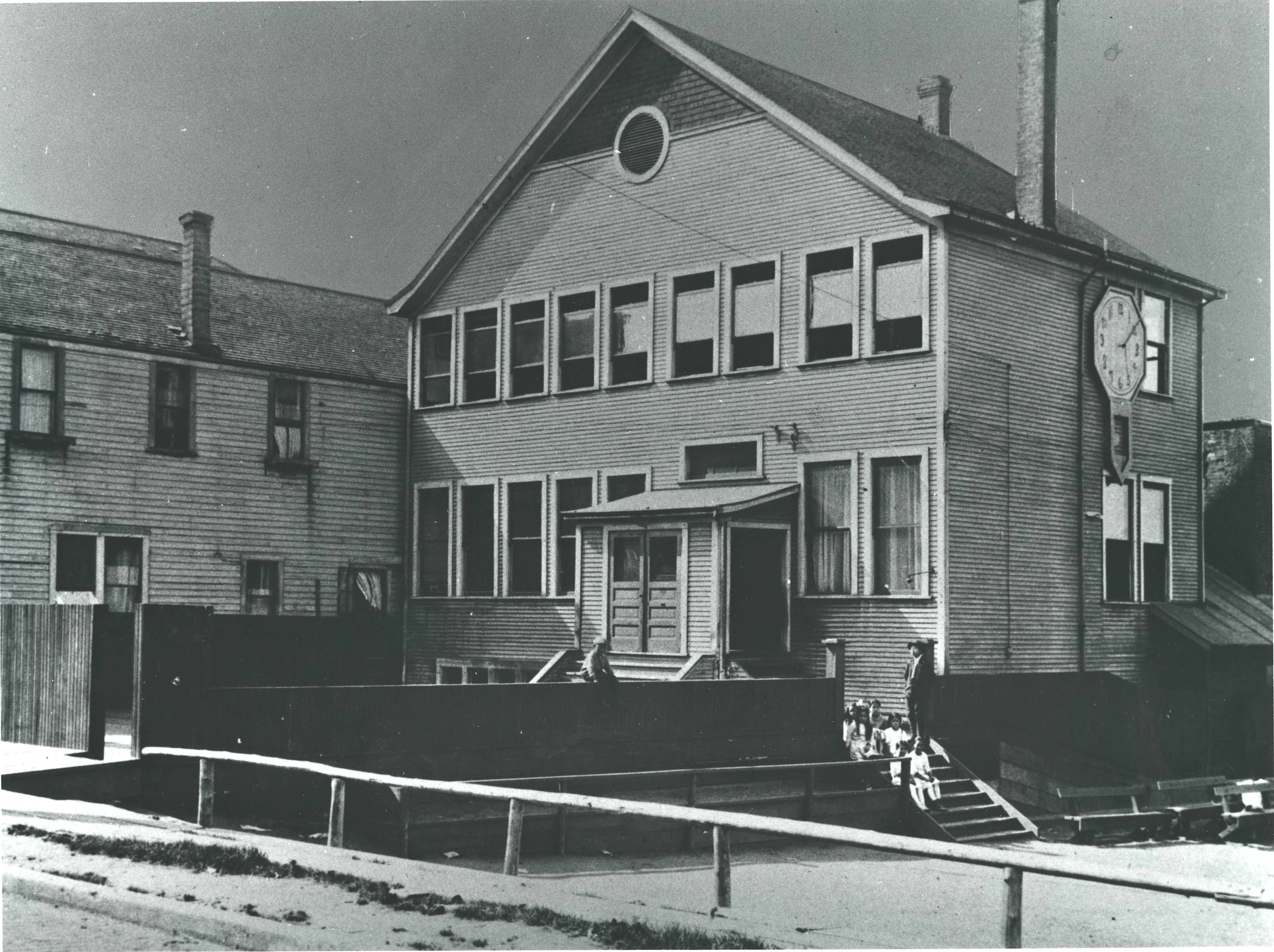 "An archival image of the ""old"" two-story schoolhouse at 439 Alexander Street."