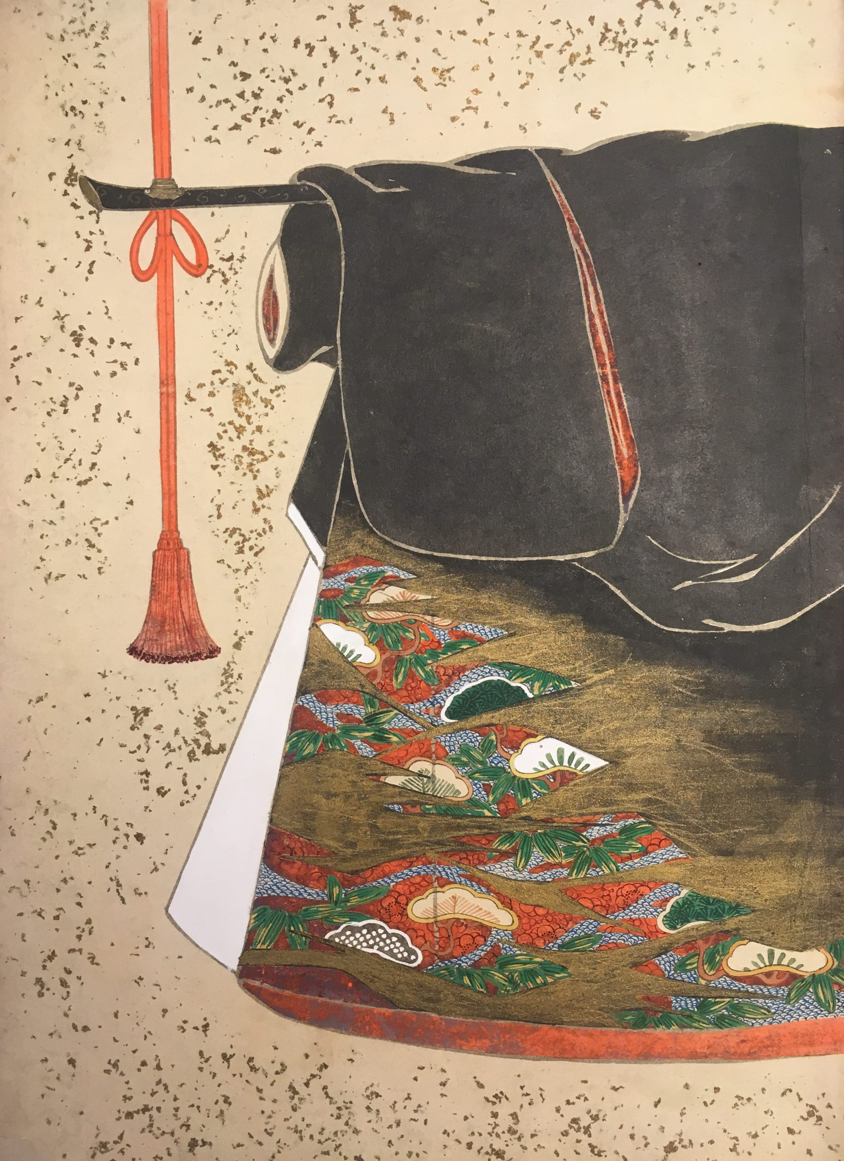 A depiction of a black kimono with a red-orange and white interior. In the lower outside corner is a staggered series of painted fans.