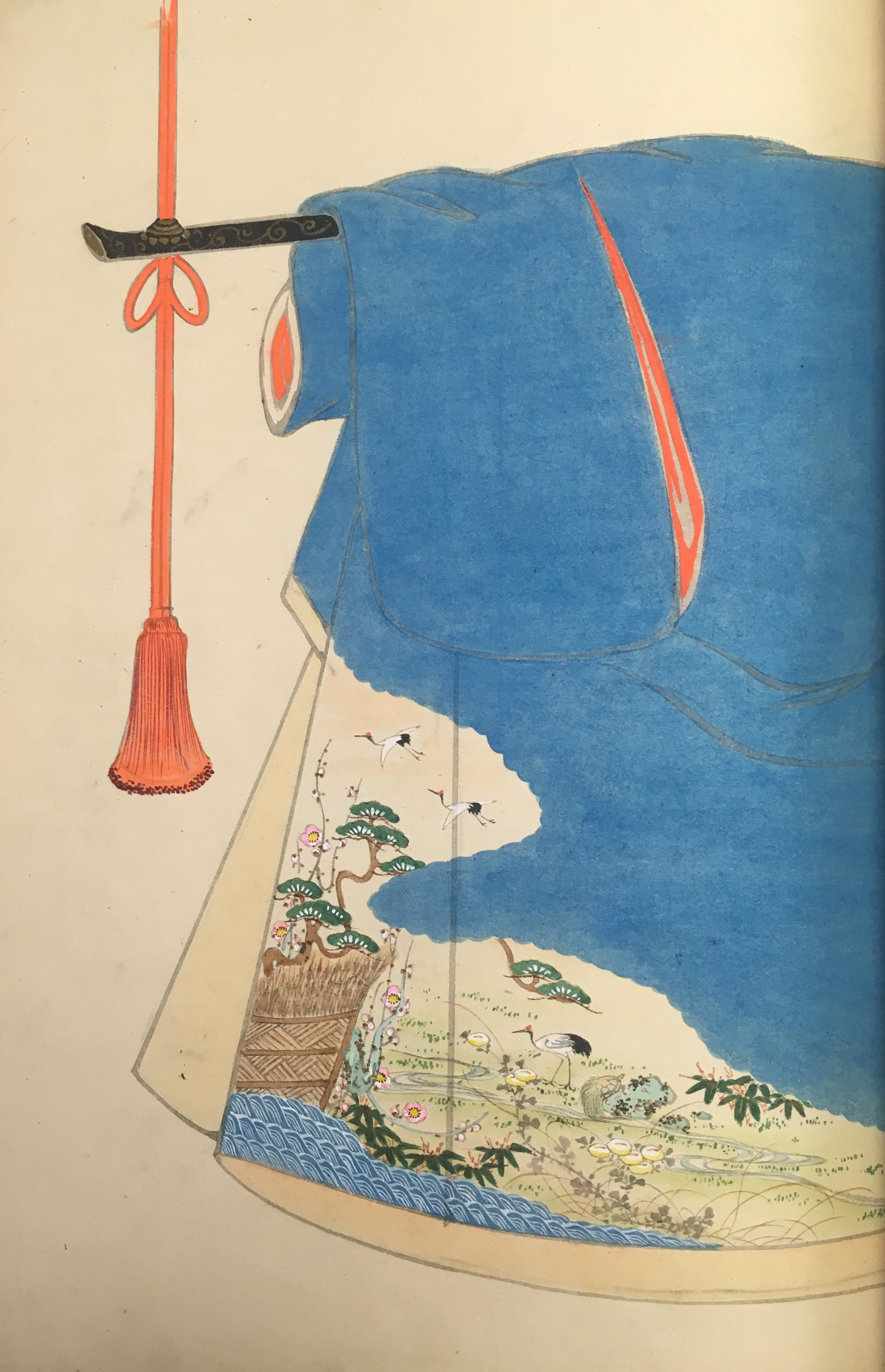 A blue kimono design. The kimono has a tan interior, and a pattern depicting a pond scene (herons, grasses, trees, and water) in the lower exterior corner.