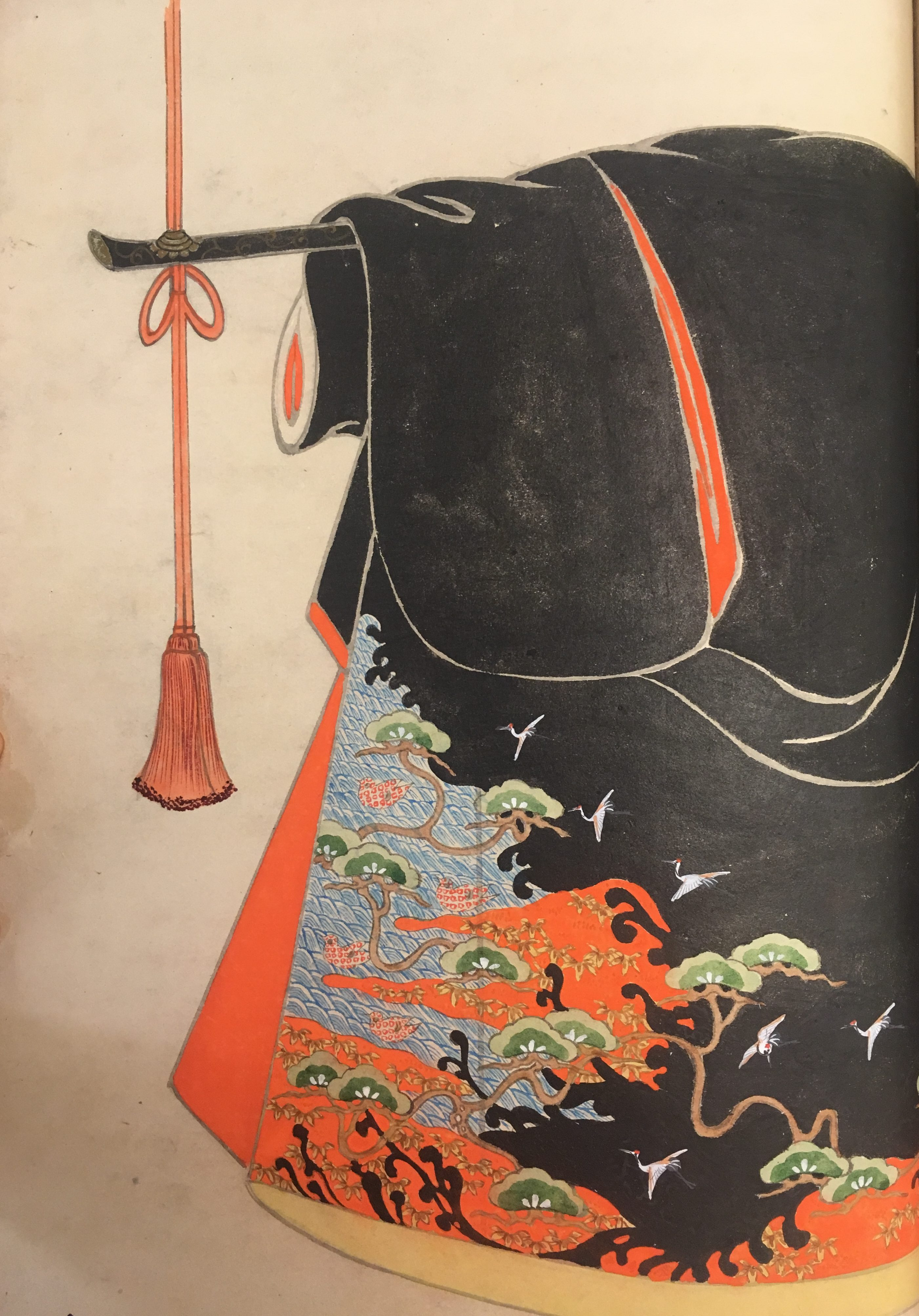 A black kimono with red-orange and tan interior. The black background bleeds into the tangle of trees, red-and-brown foliage, water, and herons.