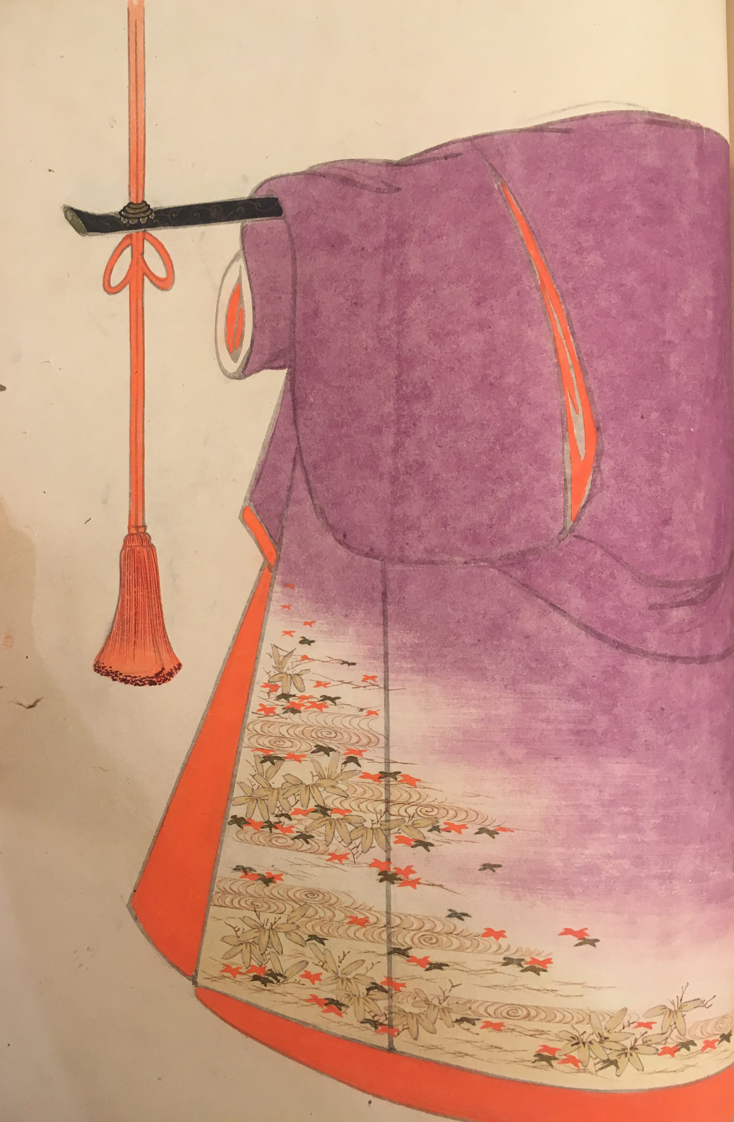 A purple kimono with red-orange interior. The interior color matches some of the maple leaves depicted in the pattern in the lower corner.