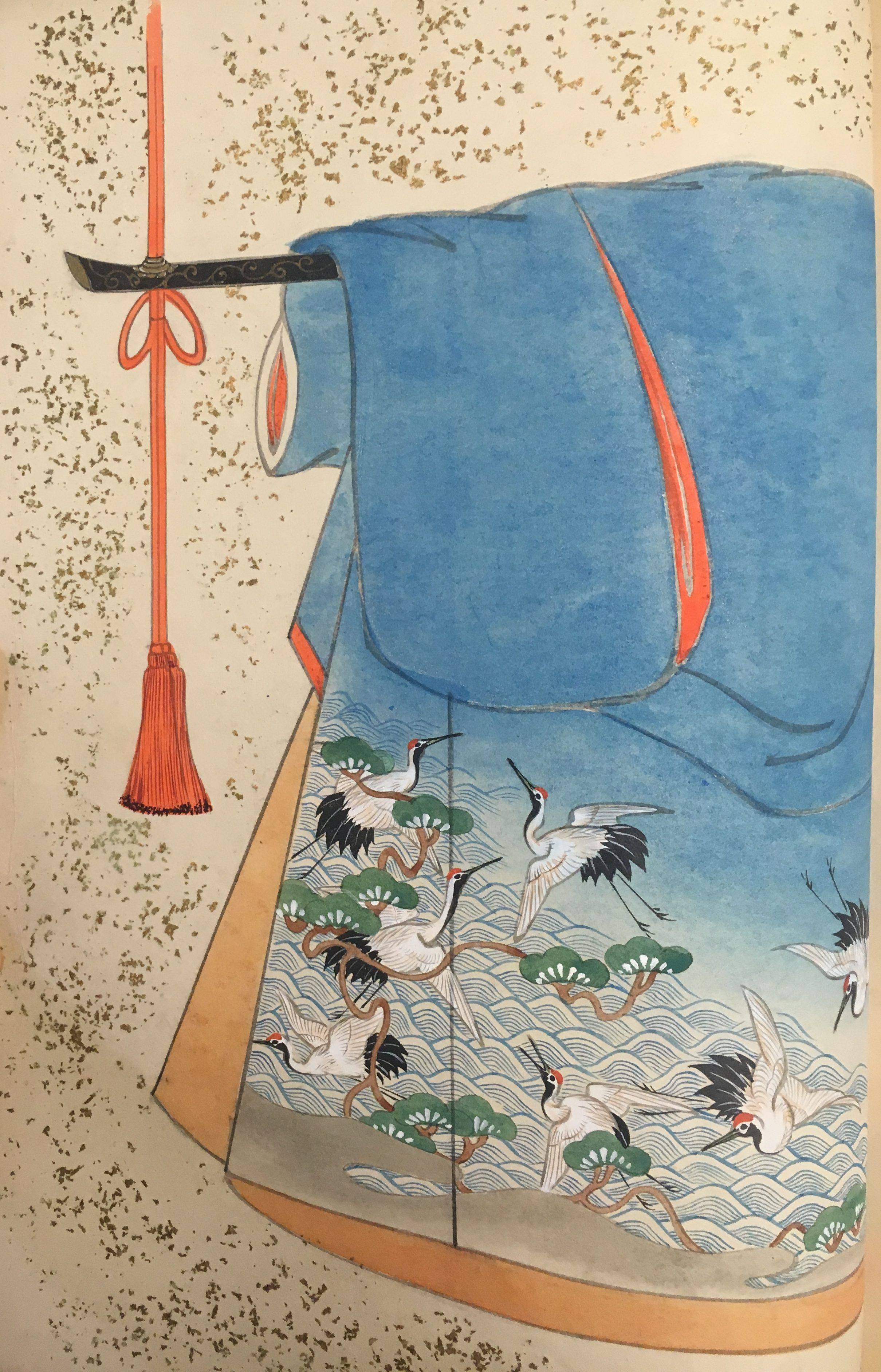 A blue kimono with tan interior. The pattern in the lower outside corner depicts herons flying together among the matsu.