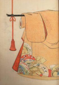 This design depicts a beige kimono with a series of painted fans in the bottom corner.