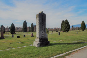 A photograph of a tall stupa with Japanese inscriptions at Vancouver's Mountain View cemetery.