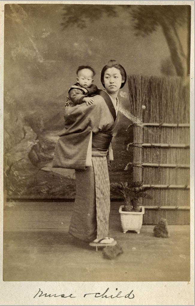 Another photo of a different Japanese nurse with a child. This photo appears to have been taken in a studio instead of outdoors.
