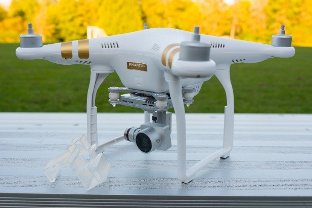 A photo of a white DJI Phantom 3 Professional UAS sitting on a table