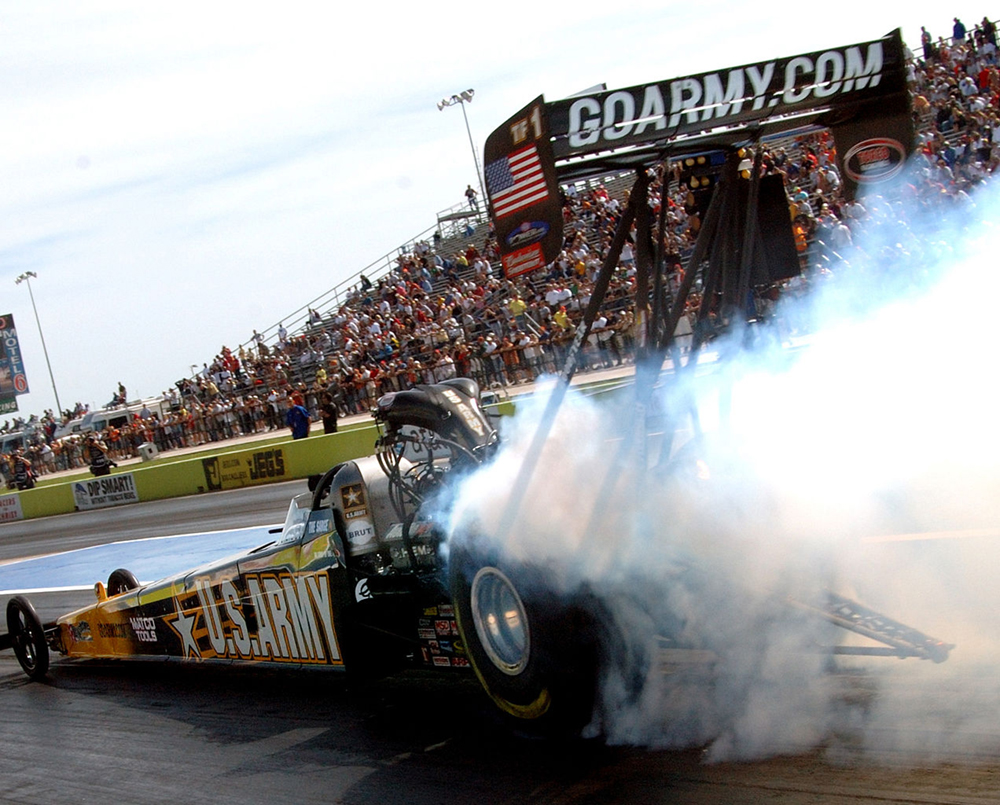 Dragster accelerating down a race track.