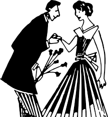 A man holds a woman's hand and offers her flowers