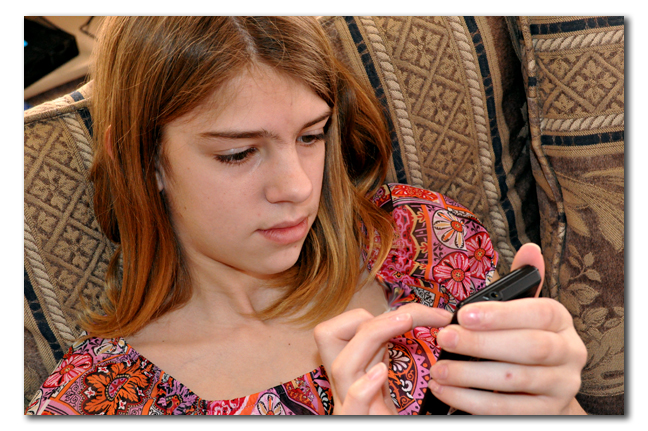 Girl texting on cellphone